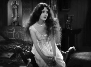 DJ's conquest enjoying a pensive moment. Film still from  'Don Juan', 1926